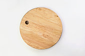 Top view of wooden cutting board isolated on a white background