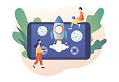Retro game online. Tiny people playing video game with rocket and asteroids using laptop, smartphone and tablets. Modern flat cartoon style. Vector illustration on white background