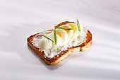 Egg and cheese sandwich with vegetable and toasted bread