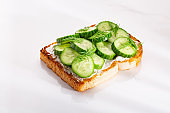 Cheese and cucumber sandwich with vegetable and toasted bread
