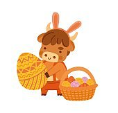 Cute ox holding a large easter egg. Little cow with bunny ears.
