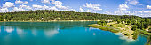 aerial panorama of beautiful blue lake and green summer forest in Belarus under blue sky