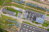 tram depot in city. industrial background. aerial top view from flying drone