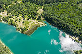 flooded quarry lake landscape with calm turquoise water. birds eyes view