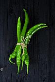 Green pepper on black