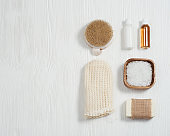 Bath accessories from natural material, zero waste set for bathroom, small bottles with gel and shampoo, soap, sea salt, washcloth