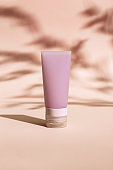Cosmetic Bottle for cream, gel, lotion. Beauty product package, mock up plastic container with dark light