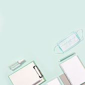 Office supplies, notebooks, pens, mask for protection from infections and hand sanitizer o