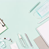School supplies, face mask and hand sanitizer, schoolboy badge, copybooks, pens