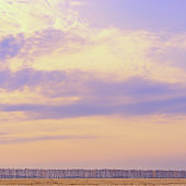 Sunset and clouds sky background with blue and yellow pastel colors. Autumn landscape in minimal style.