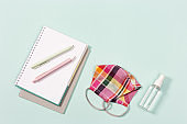School supplies, cloth face mask for girl and hand sanitizer, copybooks, pens