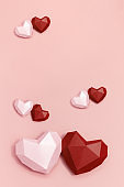 Two volumetric paper hearts red and pink colored. Greeting card or invitation for wedding cards or Valentines Day. Pastel colors.