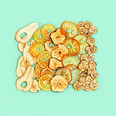 Diet Healthy snack, set of dried fruits. Dehydrated fruit chips of apple, banana, persimmon, tangerine, pear. Trendy food for vegetarian. Top view.