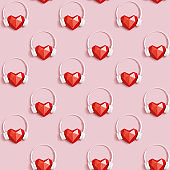 Seamless pattern with red polygonal paper heart shape in white headphones. Music concept. Dj Headset. Minimal style.
