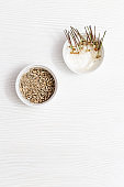 Sprouts wheat on wooden background with copy space. Healthy and vegetarian food. Germination of wheat seeds at home.