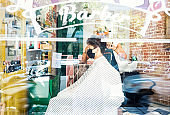 Young man have hair cutting at barber shop during coronavirus, they are protected