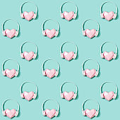 Seamless pattern with volumetric paper pink heart in white headphones. Concept for music festivals, radio stations, music lovers.  Live with music. Minimal style.