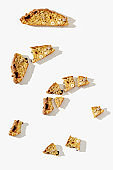 Several pieces Italian biscotti cookies on white background. Fresh broken cookies