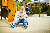 Adorable little girl on playground on a sunny day