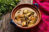 Mexican poblano pepper rajas and panela cheese on wooden background
