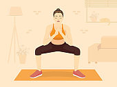 Women doing squat exercise on orange mat at the living room her home. The New normal, Fitness while Stay at Home.