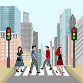 People walking across crosswalk on city street in flat design. Pedestrian crossing road with buildings on background.