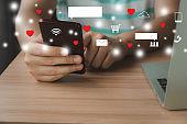 Business man using mobile phone laptop for digital online marketing on office desk.Business & finance technology concept.icon online social media marketing for internet data network technology.