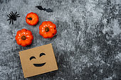 Table top view  of decoration Happy Halloween day background concept.Flat lay accessories essential object to shopping the pumpkin & sweet candy with jack o lantern on rustic stone.copy space design.