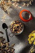 Yellow rose buds in mason jar