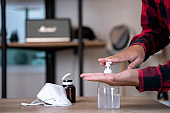 Man disinfects his hands with sanitizer, safe work, quarantine