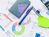 analytics graph and pie chart on many paperwork and statistical. business workplace and finance concept.
