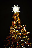 bokeh in the form of a  Christmas tree on a black background