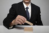 Businessman building blocks growth change insurance