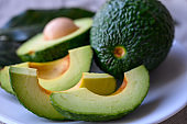 Fresh ripe green avocados with seeds ready to eat