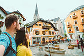 travel couple in hallstatt austria point straight ahead