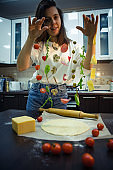 woman making pizza ingredients like salami mushrooms olive cheese freeze in air