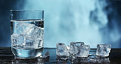 A glass of pure fresh water is poured into a glass, the background bedroom, nature, from which the fresh and pure water