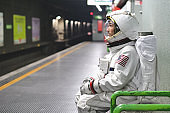An astronaut just landed from space, on the new planet, explore the new world and live there.