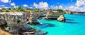 """Wonderful sea scenery in Puglia. """"Torre di Sant Andrea"""" - famous rock formations near Otranto. Italy"""