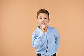 child showing shh sign