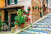 Charming floral streets of old traditional villages in Italy. Casperia, Rieti province