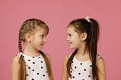 two happy beautiful little girls in dress