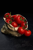 red tomatoes in paper bag