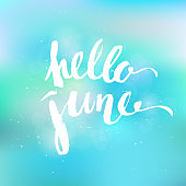 Hello june hand lettering on turquoise blurred background