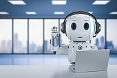 cute artificial intelligence robot with notebook
