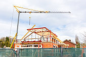 Construction site with crane and house