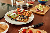 Set with toast bread and different healthy vegetarian toppings on the plate. Vegetarianism, healthy food concept
