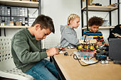Excellence in every experience. Young technicians making toys at a technology class. Smart kids and STEM education.