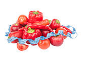 Diet concept: Set from red bell pepper, red hot chili pepper and apple with measuring tape