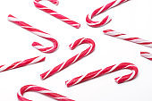 Multiple Christmas candy canes on a white isolated background white / red Christmas candies. candy pattern